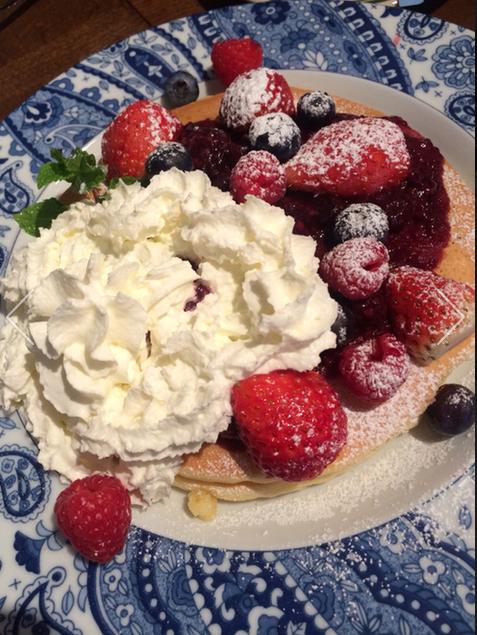 Pancake with fruits and fresh cream